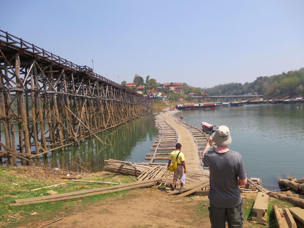Bamboo foot bridge next to the crumbling Mon Bridge