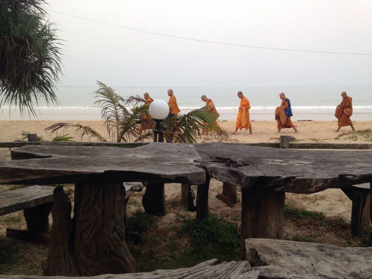 Monks on a morning beach walk Thailand