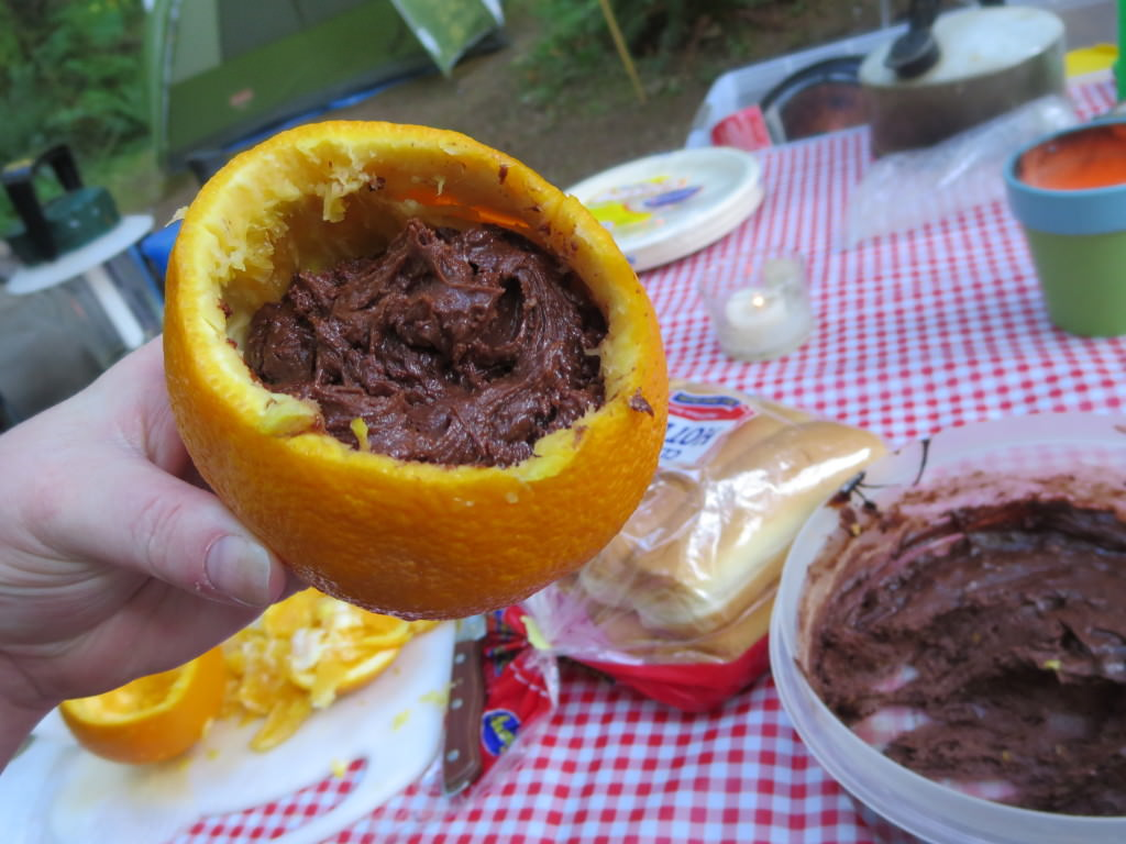 brownie batter cooked in an orange camping