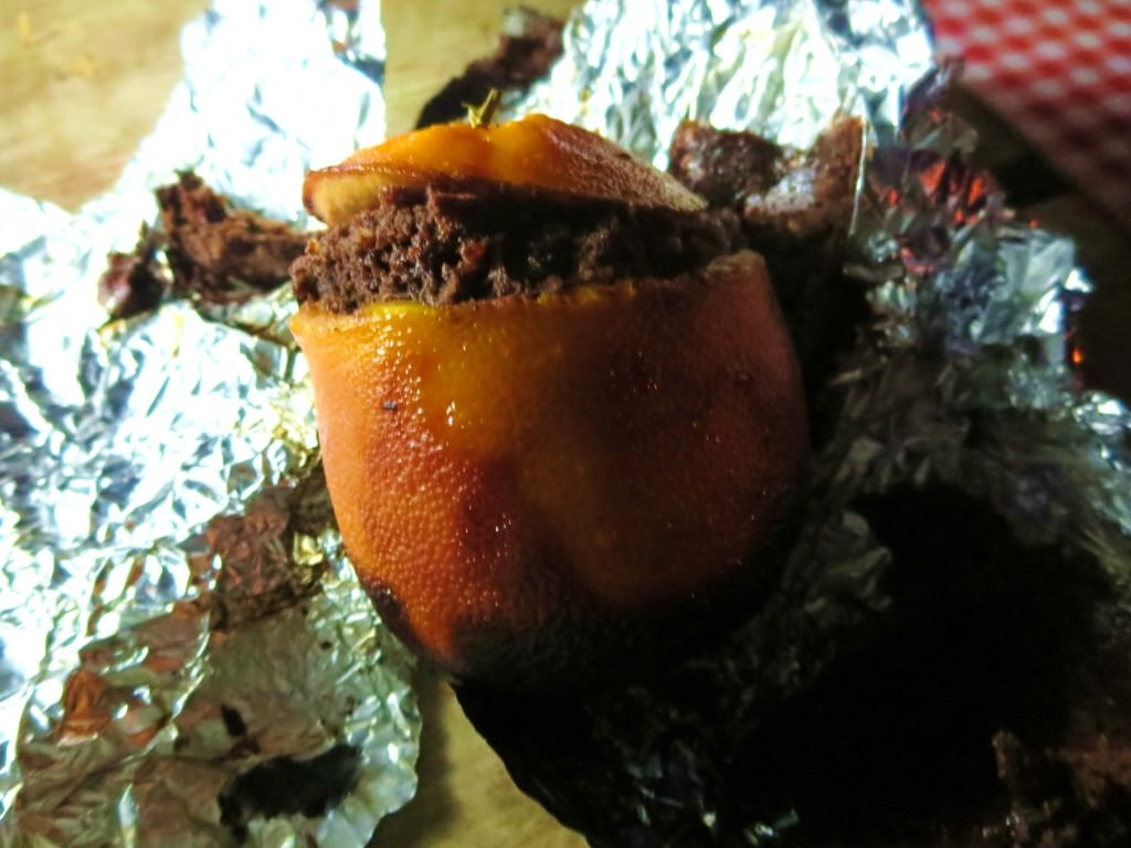 brownies cooked in an orange in campfire