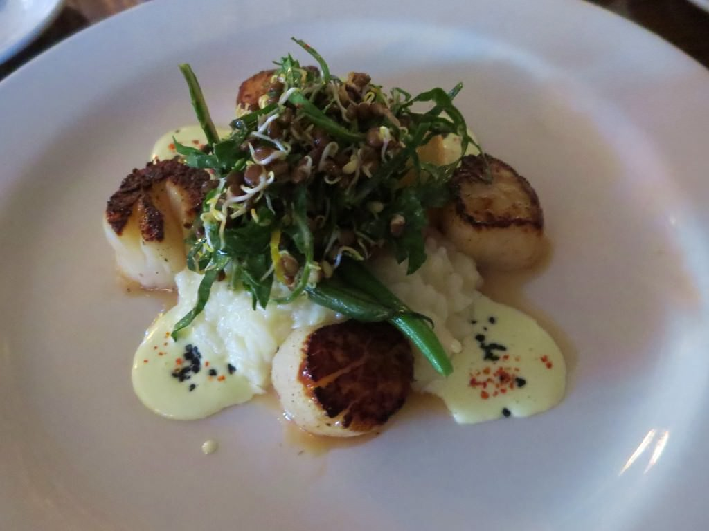 Weathervane scallops with citrus risotto, sprouted lentil salad, and lemon aoli