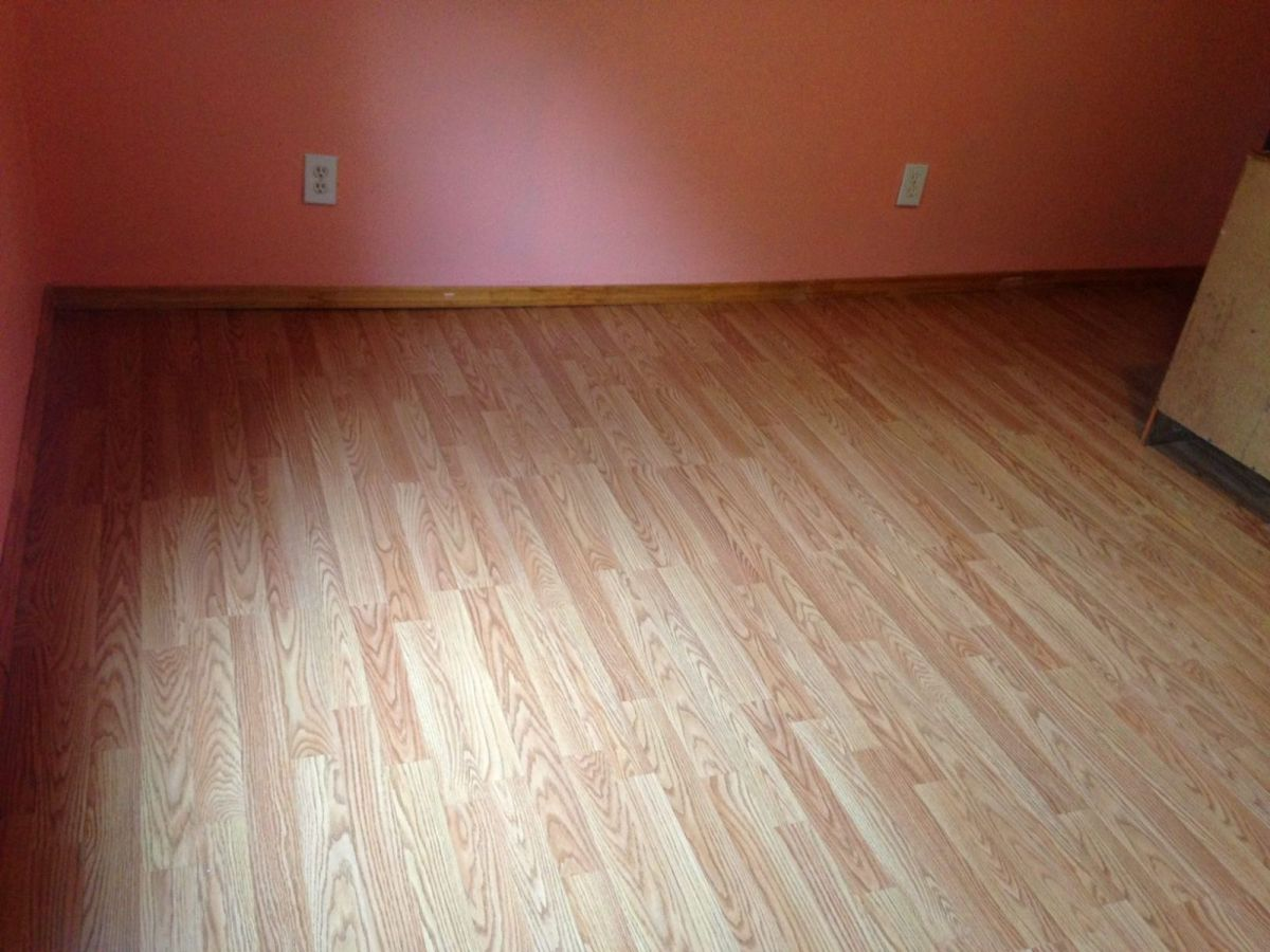 Adventures in home improvement installing laminate for Installing laminate wood flooring