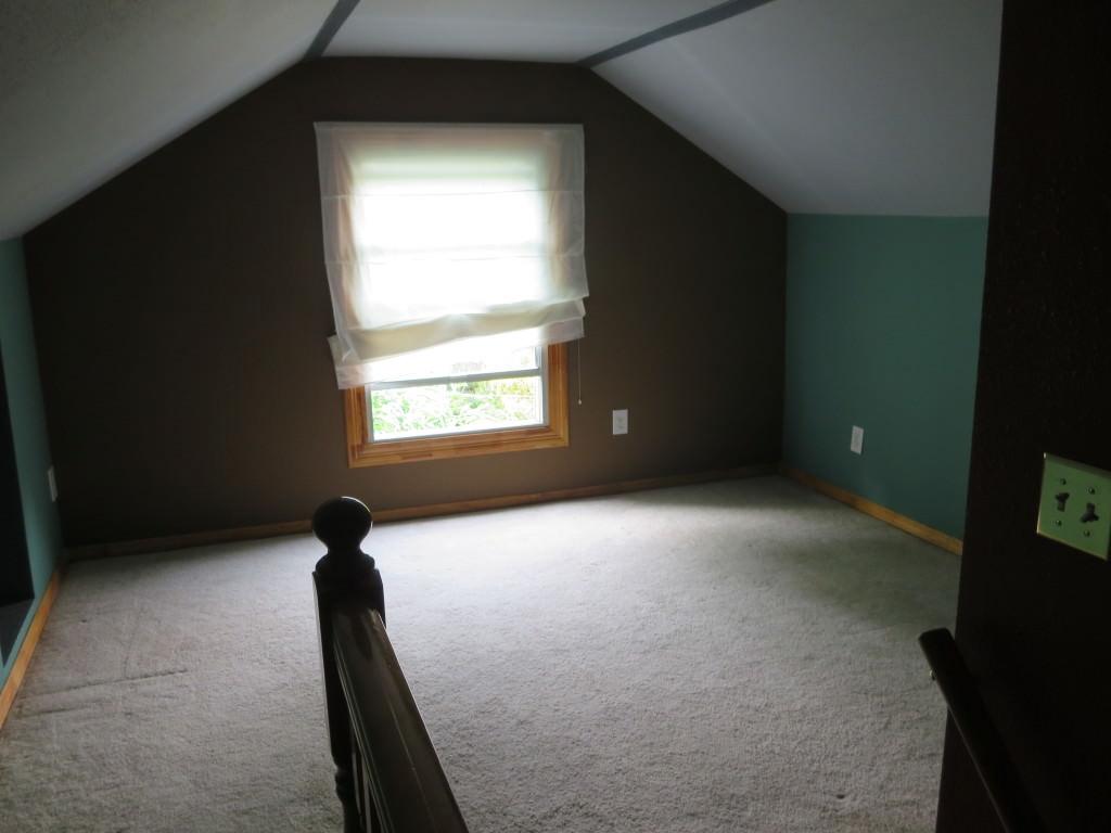 Attic before paint and installing laminate flooring