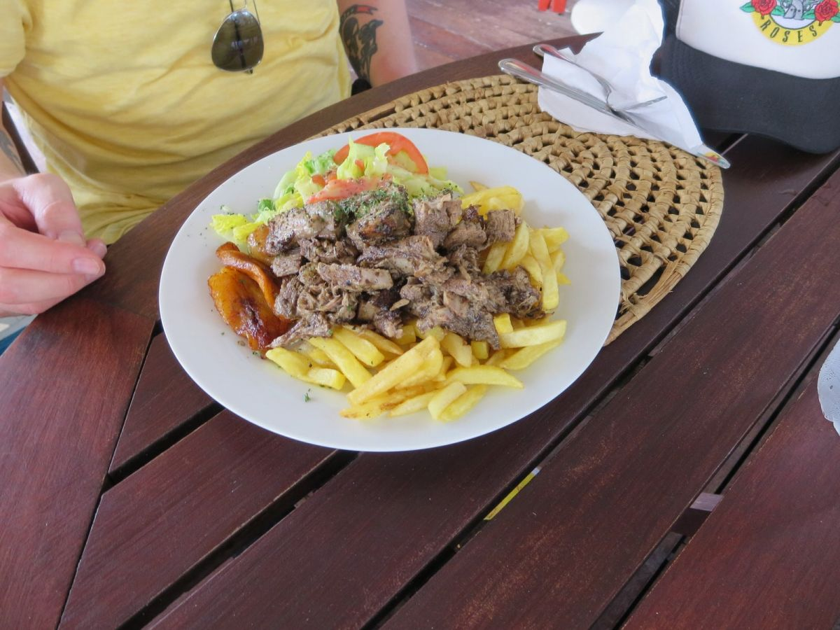 Jerk pork dish with fries at Rolli's