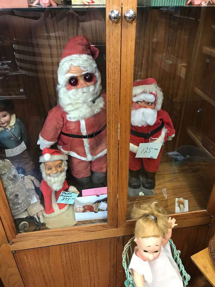 Creepy antique Santas in Rocking Horse Mall, Lincoln City