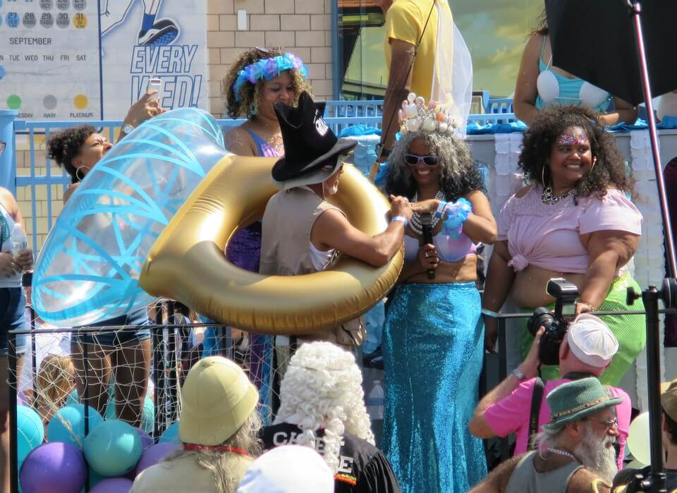 Real wedding on a float in the Coney Island Mermaid Parade, officiated by the MC